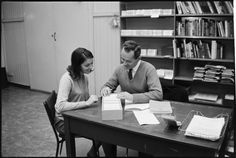 319469PD: Country librarian Lesley Kean receives induction training from Mr Hickson at the Library & Information Service of W.A. headquarters, 1966  https://encore.slwa.wa.gov.au/iii/encore/record/C__Rb3430640