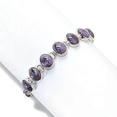 Gem Insider™ Sterling Silver 10 x 8mm Oval Charoite Link Toggle Bracelet - 138-255  Retail Value: $206.50 ShopHQ Price: $144.50 Clearance Price: $83.62    Save: $60.88 (42% off) or  6 ValuePay®:  $13.94 Shipping & Handling: $6.99
