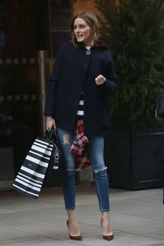 Olivia Palermo out in London. See all of the model's best looks.