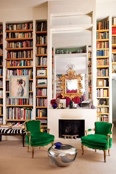 Built-in bookshelves accentuate the dramatic height of the ceiling in Jane Pendry's Paris living room, while the two antique chairs covered in Lelièvre velvet bring the eye back down to earth.