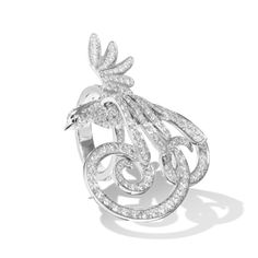 I am not particularly sold on wedding rings, but if I was this would be it. Van Cleef bird of paradise between the finger ring.