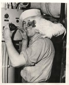 1945- Little George, rooster mascot of submarine U.S.S. SKATE, stands on the shoulder of sailor as he prepares to sound reveille over the sub's speaker system.