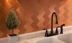 They used a brick pattern and enhanced it will copper tiles turned in diamond shapes symmetrically on both sides. Description from backsplashespictures.com. I searched for this on bing.com/images