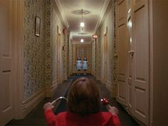 Stanley Kubrick - The Shining.  Overlook Hotel was beautiful and scary at the same time. This shot here is unbeatable...in anyway