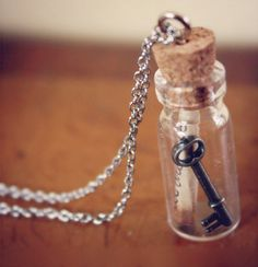 Very unique vintage inspired necklace. Bottle is made of glass with a cork top. Key is made of metal. Includes a small rolled up rustic-looking paper.