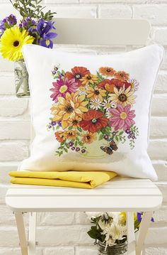 Summer floral cushion. This design featured in issue 252 of Cross Stitch Collection magazine. Back issues are available from http://www.crossstitchcollection.com/back-issues/