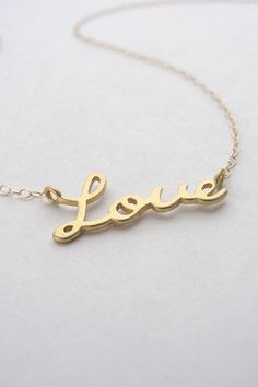 Gold Love Necklace love script necklace in gold