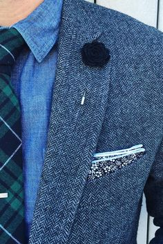 Ryne Hammons is looking dapper in our modern slim herringbone gray wool suit jacket. He styles it with a chambray button down, green plaid tie and floral print pocket square | Banana Republic