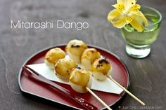 Mitarashi dango is a traditional Japanese sweet, consist of warm soft grilled mochi ball covered in a sweet soy sauce.