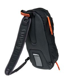 Superdry Camping Detroit small rucksack. Single shoulder strap design, with padded and ventilated back panel. Main compartment with inner pouch, outer compartment and extendable mesh panel for extra carrying capacity. Printed bag and strap logos. Storm zips.