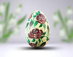 Pisanka malowana ręcznie z równomiernie rozmieszczonym wzorem burgundowych kwiatów. Easter Eggs