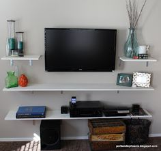 DIY: TV Shelves  Also, hide cords: http://www.houseofhepworths.com/2012/01/10/mounting-your-tv-to-the-wall-and-hiding-all-the-cords/