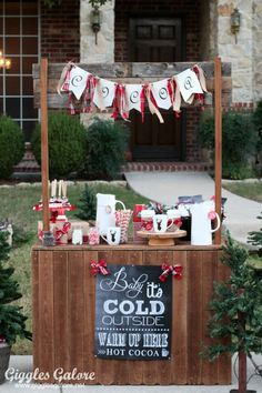 Hot Cocoa Stand for Charity via Giggles Galore >> #WorldMarket Share the Joy -- Proceeds donated to local shelter.