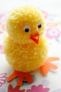 This bright yellow pom pom chick is something kids will love to sew