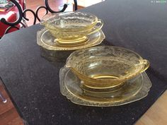 Robin's two Madrid depression glass gravy boats with underplates.