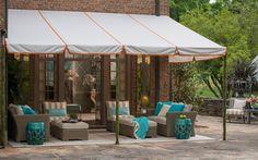 Sunbrella fabric awning with orange piping