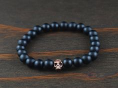 • Matte Onyx Bracelet. Mens Skull Bracelet. Onyx Bracelet with Copper Skull Bead. Mens Beaded Bracelet. Mens Mala Bracelet. Yoga Bracelet for Men.