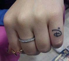 Small Disney Tattoo on pinky finger, so cute!