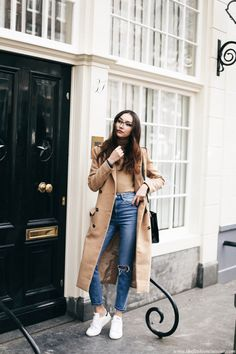 camel bodysuit shirt + trench coat + ripped high-waisted skinny jeans + white Adidas Stan Smith sneakers