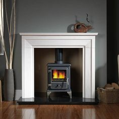 The Penman Collection Torino fireplace suite consists of 1 x Torino Portuguese limestone surround, reeded fireboard chamber, 1 x x Slabbed black granite x inner hearth and Optional Vega 100 multi fuel stove. London Living Room, Home Living Room, Living Room Decor, Living Area, Bedroom Fireplace, Fireplace Design, Log Burner Living Room, Wood Burner Fireplace, Livng Room
