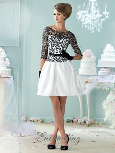 Three-quarter sleeve satin, tulle, and lace above-the-knee A-line dress, lace illusion bateau neckline, semi-sweetheart bodice with deep scoop back, detachable satin belt at natural waist, flared skirt with concealed side pockets. Sizes: 4 – 20 Colors: Black/Ivory, Ivory