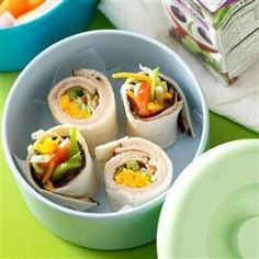 Turkey Ranch Wraps Recipe -Here's a cool idea that's ready to gobble up in no time. It's a terrific use for deli turkey. Just add lettuce, tomato, green pepper, shredded cheese and ranch dressing for a flavorful blend. —Taste of Home Test Kitchen