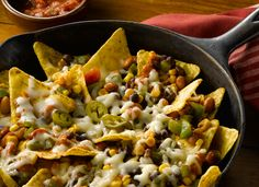 Cowboy Chili Skillet Nachos Recipe. Great for last minute idea.  Add any ingredients you have in the fridge and can be done in the oven, on the range, or on the grill.
