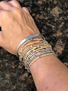 """""""Love these bracelets! I have worn them for years. I mix them up and wear multiple colors at a time. I work, play and live in them. I love telling people about the cause when they compliment me on them."""" - Pamela B. African Jewelry, Bangles, Bracelets, Modern Jewelry, Compliments, Jewelry Design, Romantic, Play, Live"""