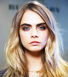 Cara Delevingne went for a smoldered in a sultry brown smoky eye and kept the red of her makeup to a minimum