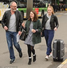 Casual: The gang shared a giggle as they made their way through the airport