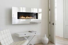 he West Country Fires X-Fire range is noted for its fusion of stunning design and productive performance and now you can get those benefits in a slightly smaller package to suit more modest interiors – the X-Fire 1000 Mirror finish. Mounted Fireplace, Stove Fireplace, Fireplace Wall, Bathroom Mirror Inspiration, Contemporary Gas Fires, Flueless Gas Fires, Installing A Fireplace, Build A Wall, White Walls
