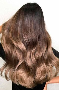 A brown hair color is extremely underappreciated. There are so many variations of brown that you may spend your whole life looking for the perfect one for yourself. Get inspired from our gallery of ideas. #haircolor #brownhair #brownbalayage