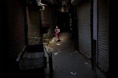 An Indian schoolgirl walks through an alley in New Delhi, India, Thursday, Aug. 28, 2014. (AP Photo/Bernat Armangue)