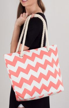 This is this year's beachy essential! This perfect coral chevron beach bag has nautical rope straps, is fully lined and has a small zipper compartment for storing all the important things.