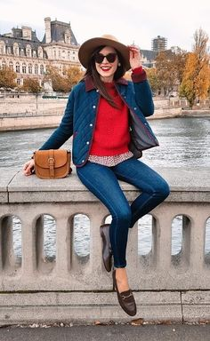 The fascination with red continues, this time contrasted against another primary color: denim blue. #winteroutfits #winterfashion #jeans