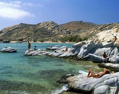 Taking in the sun at Kolymbithres Beach in Paros, Greece.