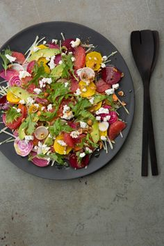 shaved root vegetable salad with goat cheese and hazelnuts