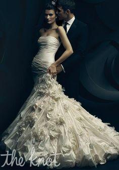 Ines de santo. Gown features handmade silk flowers.