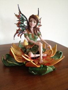 Sunflower Fairy is another one of my favorite fairies.  She is for sale on my Etsy page, Angelsforallofus.  She has a strong base made of Apoxie Sculpt and wings made of angelina film embellished with microbeads and glitter.