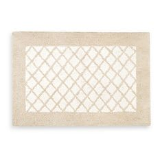 This elegant bath rug combines a traditional diamond pattern in a two tone tufted body. The classic style of this bath rug will lend a luxe, stylish touch to your bathroom.