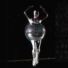 """""""Trip the Light Fantastic!"""" I made a costume for our local wearable arts show in February 2011. I used thousands of miniature mirrors- and made myself into a human disco ball! VERY heavy (about 40 lbs). Had a lot of fun with this one!!"""