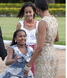 #President Of The United States  #BarackObama #FirstLady Of The United States  #MichelleObama #FirstDaughters Of The United States  Malia & Sasha #Obama greet their mother, First Lady Michelle Obama, after getting out of the motorcade upon arrival for a reception hosted by Brazilian President Dilma Rousseff at the Palacio do Alvorada, the official residence in Brasilia, Brazil, March 19, 2011.