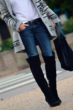 black knee high boots. long grey patterned sweater jacket