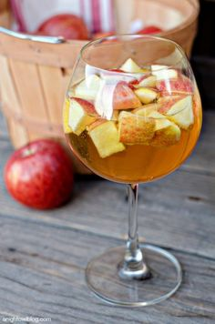 Carmel Apple Sangria :: recipe tweaks: maple syrup, instead of caramel & maybe a still cider, instead of sparkling?