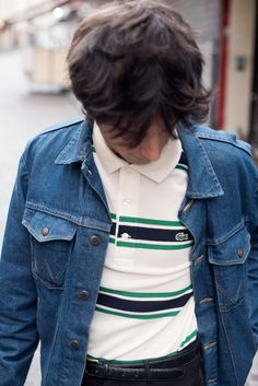Jeremy Kapone in Paris wearing his regular fit striped green and white Lacoste polo paired with an urban denim jacket.