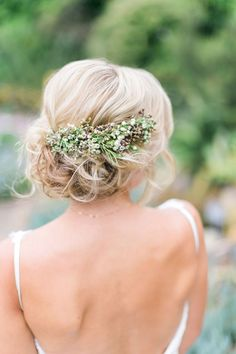 blonde updo with swath of tiny flowers