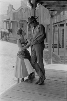 Miss Kitty and Matt Dillion: This shot resembles Alan and I in Ft Worth Cowtown where we first met 21 years ago...OMGoodness he was a hot cowboy and I was the saloon singer! Perfect!