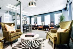 Modern office interior design and stylish blue chair the for Zynga office design