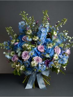 Wild At Heart - Blue Skies Bouquet - Reflecting the blue skies of summer, this striking bouquet is made up of lilac roses, delphinium, hydrangea and nigella.