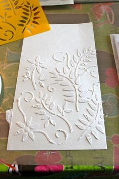 Stencils  Gesso tutorial.  Shows how to add colors with oil pastels and watercolor.